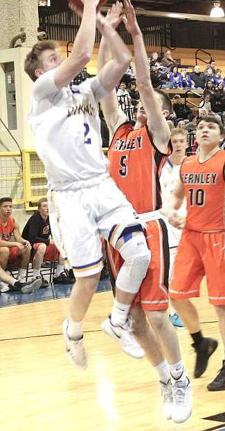 Zach Burns, 5, tries to stop a basket by South Tahoe's Harry Moses-Chakmakis during the Northern 3A regional tournament.