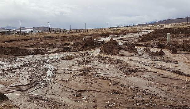 Mud oozes over Opal Avenue in Silver Springs as a result of heavy rains in central Lyon County.