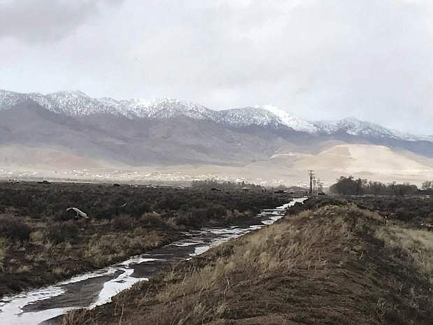 On the opposite side of Dayton Valley Road, near Sydney Lane and Rancho Road, is the remaining water of the diversion which caused an overflow in a pond Tuesday afternoon, influencing a flood warning.