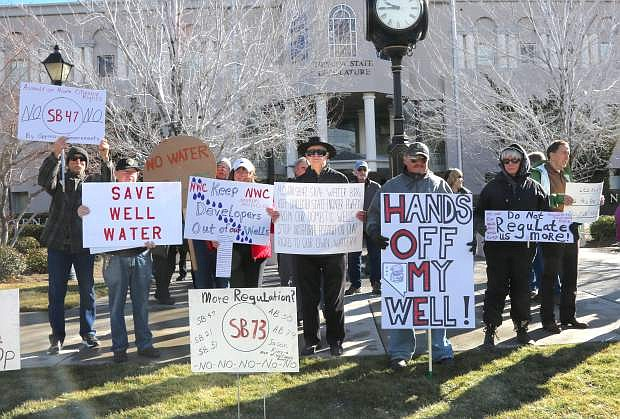Demonstrators gather in front of the Legislature to protest proposed bills that will reduce and restrict private water wells.