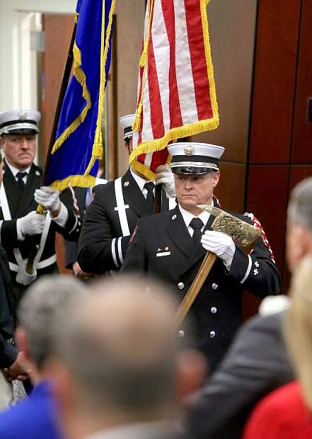The Reno Firefighter Association's Honor Guard presents the Colors in the Assembly Chamber on Monday.