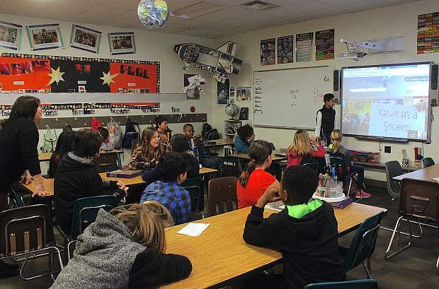 Victoria Purrell's fifth-grade class does a Google Hangout with fifth-graders in Arcadia, Calif., figuring out the other's location by answering questions about geography, weather, the economy, food and attractions.