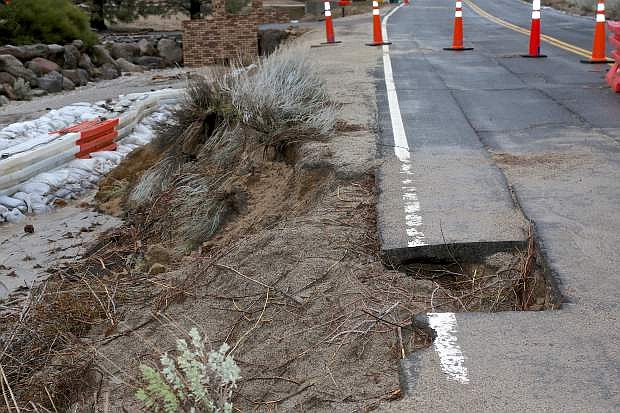 Combs Canyon Rd. has a section of pavement missing Friday due to floodwaters.