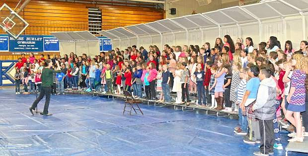 Area elementary choir students rehearse for 'Choirpalooza' Thursday in the Morse Burley Gymasium at CHS Thursday.