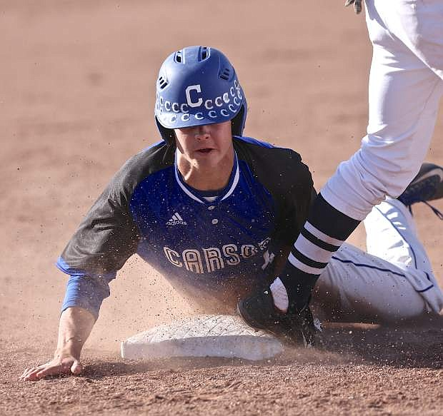 Carson's Brandon Gagnon belly-slides into third base during a playoff win against Damonte last season.