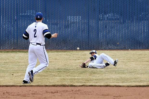 Joe Tonino makes a diving attempt to catch a flyball for Carson on Friday.