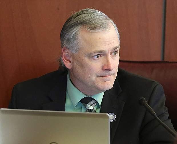 Senate member James Settlemeyer listens to public comment regarding Senate Bill 271 on Tuesday.