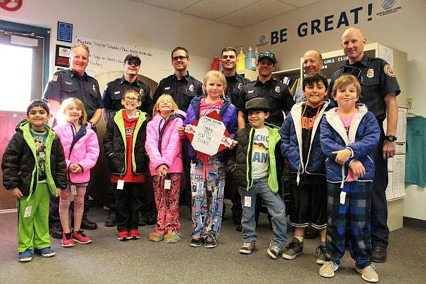 Members of the East Fork Professional Firefighters deliver brand new, American union made warm winter coats to members of the Boys & Girls Clubs of Western Nevada Carson Valley Clubhouse.