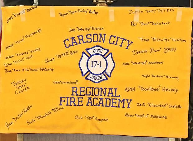 A small banner hung on the podium with all of the graduates signatures and nicknames Friday night at the Nugget.