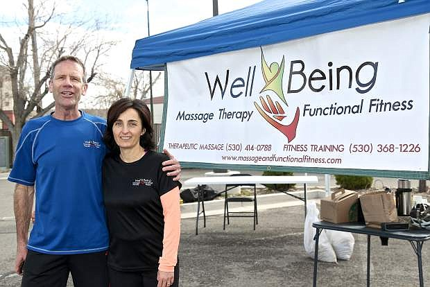 Well Being Massage and Functional Fitness owners Brad and Alina Paula wait for 5k runners to finish during the Fitness For Life grand opening Saturday morning in Carson City.