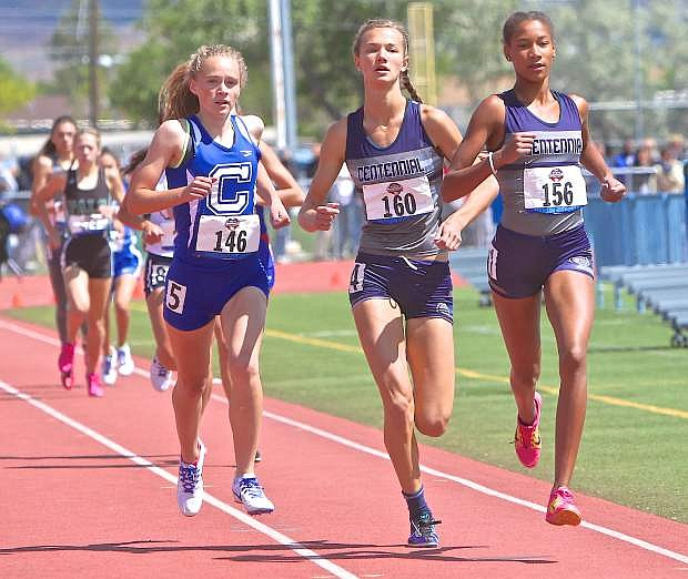 Carson freshman Abby Pradere keeps pace with Centennial's Karina Haymore (center) and Alexis Gourrier (right) in the Division I 1600-meter race at last year's NIAA State Championships at Carson High School.