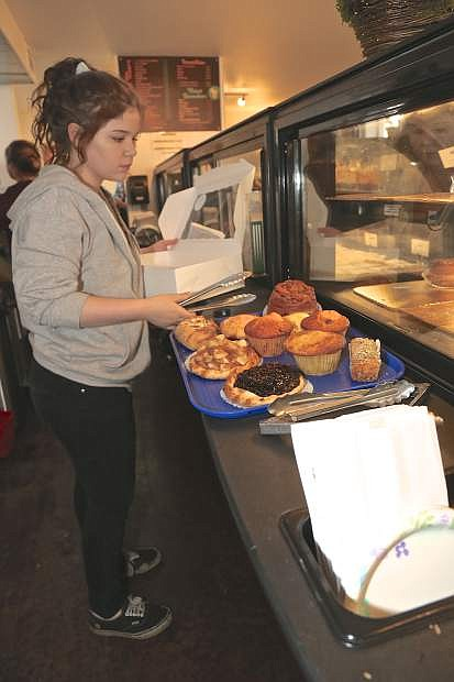 Daelyn Sebold prepares an order of pastries at LA Bakery Thursday morning in Carson City.