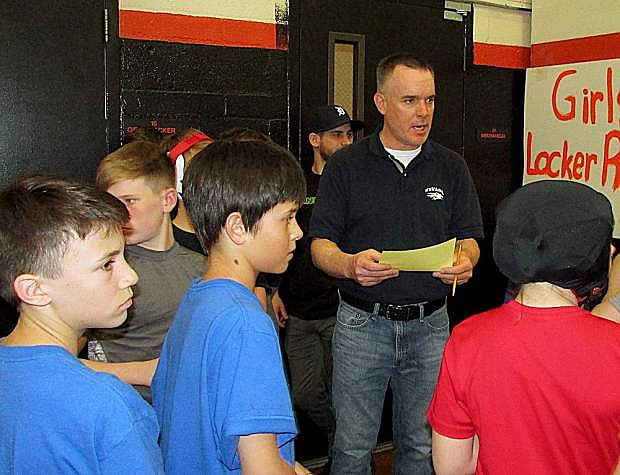 Tim McCarthy instructs middle school wrestlers on match assignments Saturday during a Tah-Neva League wrestling tournament Saturday at Carson Valley Middle School. The league championships will be held this Saturday at Pershing County High School in Lovelock.