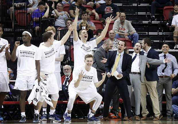 The Nevada bench reacts after a 3-point shot during the first half Saturday.