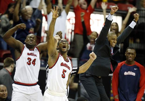 Fresno State's Jahmel Taylor (5) reacts after sinking a 3-point shot in the final moments of the team's NCAA college basketball game against New Mexico in the Mountain West Conference tournament Thursday in Las Vegas.