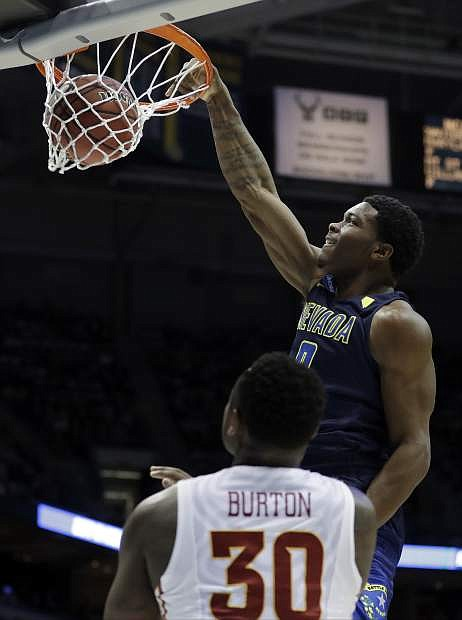 Nevada's Cameron Oliver (0) dunks as Iowa State's Deonte Burton (30) watches during the first half of an NCAA college basketball tournament first-round game Thursday, March 16, 2017, in Milwaukee. (AP Photo/Morry Gash)