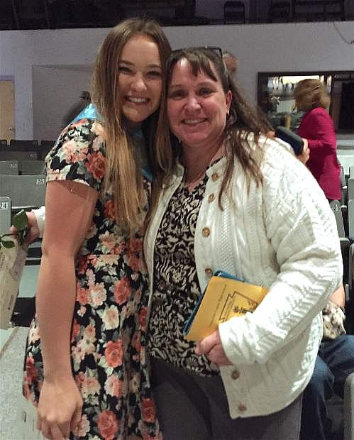 CCHS senior and National Honor Society inductee Stacy Kalt embraces one of her favorite teachers, pre-calculus instructor Elena Marsh.