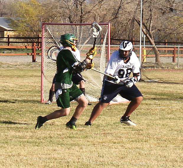 Frederick Devyn, 98, battles a Bishop Manogue player for the ball.