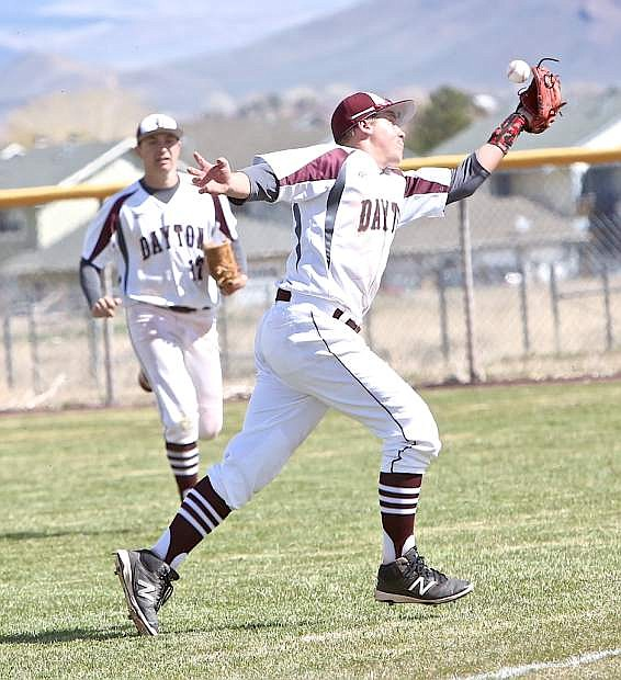 Dustdevil 2nd baseman Zach Woitas juggles the ball before bringing it in for an out Saturday against Spring Creek.