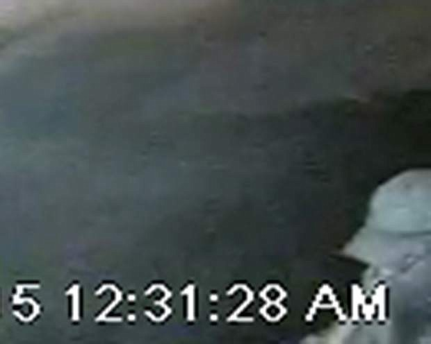 A home security camera photo of the man sought in the case of threats made against Carson City Judge John Tatro.