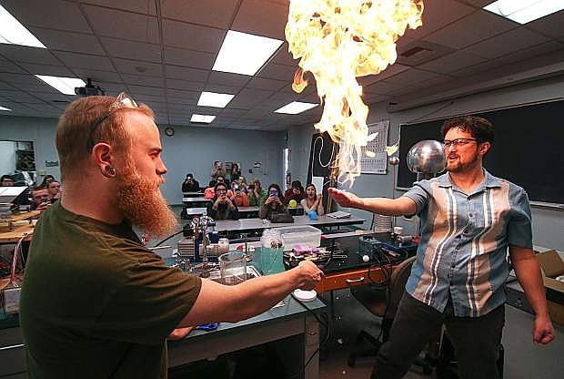 Physics Professor Tom Herring, right, and Lab Assistant Jordan Dargert teach high school students about science at Western Nevada College on Feb. 19, 2016.