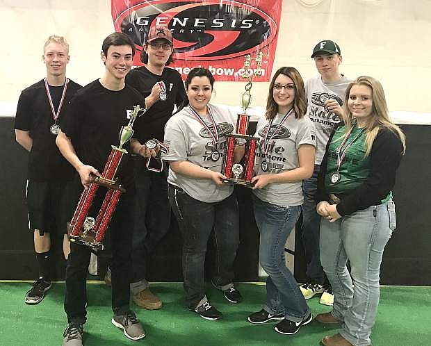 Members of the Churchill County archery club show off their awards after winning third in the state archery tournament. Left to right are Koda Biggs, Broder Thurston, Sterling Lee, Emily Dixon, Lana Quint, Cody Sponsler and Sienna Burgess.