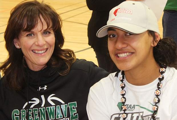 Coach Anne Smith and Greenwave player Leta Otuafi chat before the ceremony begins at the Venturacci Park gym.