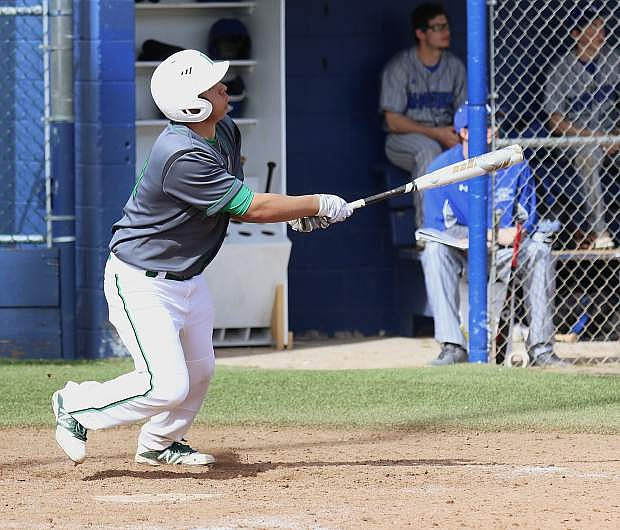 Fallon catcher Edgar Alvarado hits his second home run of the game against McQueen on Saturday in Fallon's only win of the Mike Bearman Memorial Tournament in Sparks.