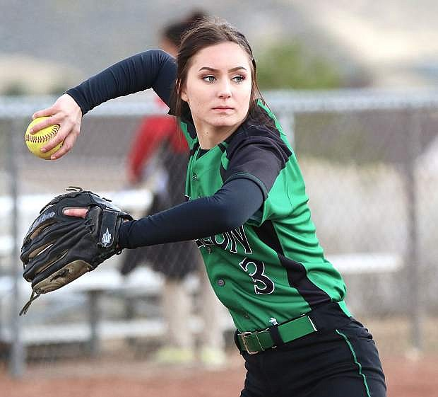 Fallon's Rylee Buckmaster throws to first against Truckee on Saturday.