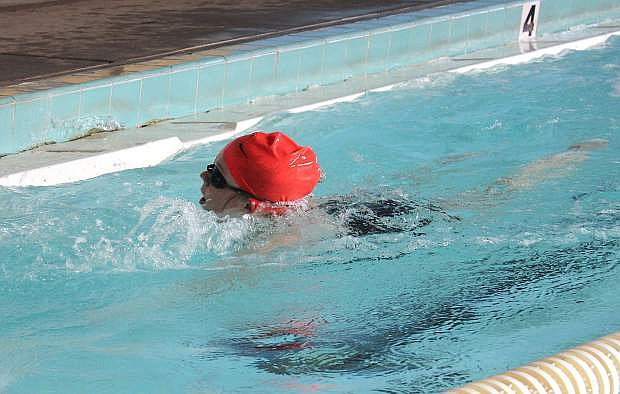 A member of the CCHS girls' swim team prepares to flip for her return lap during a practice.