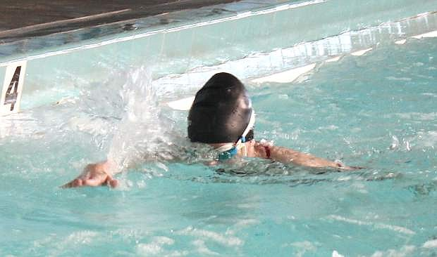 Amanda Impastato pushes through the water during a Greenwave swim team practice.