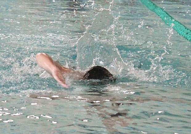 Dominic Schulenberg cuts through the water as he practices his stroke.