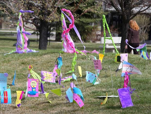 The socially-engaged art installation, titled 'Unraveling Inequality' was set-up Monday on the lawn in front of the Legislature Building. It was created by community members ranging in age from youth to seniors and presents the issues they want addressed during this Nevada Legislative session.