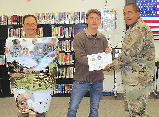 From left are Army Staff Sgt. Jonathan Serna, CCHS student Tallon Amezquita and Army Capt. Stefan Wilson.
