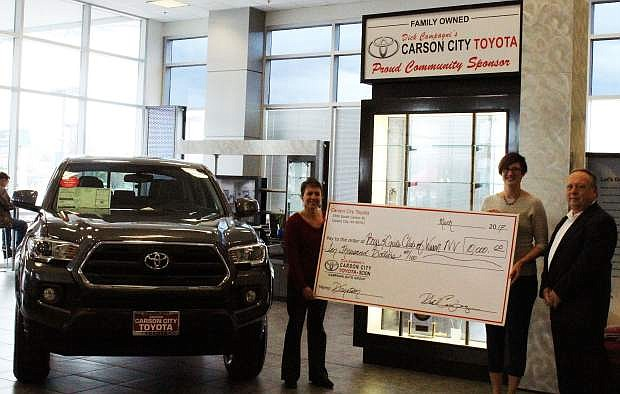 Andie Wilson, president of the board of directors, and Katie Leao, chief professional officer for the Boys & Girls Clubs of Western Nevada, receive the Carson City Toyota Scion Community Challenge matching funds in the amount of $10,000 from Dana Whaley, general manager for Carson City Toyota Scion.