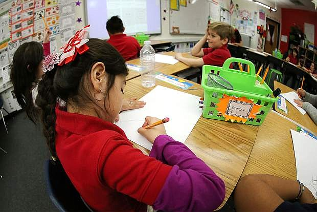 Second-grader Daniella Saenz-Cabuto, 7, draws during an art lesson at Empire Elementary School on Friday.