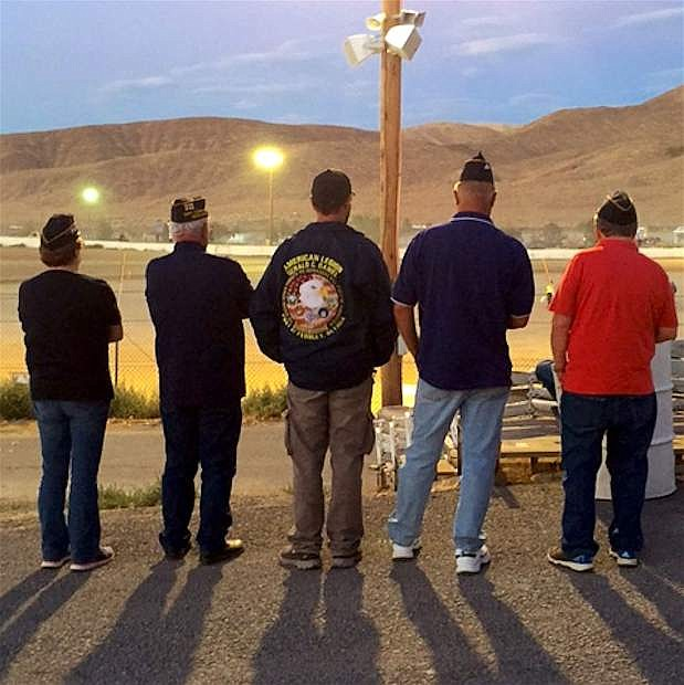 First female commander of Fernley's American Legion post Valerie Scheuering stands with her male commrades in arms.