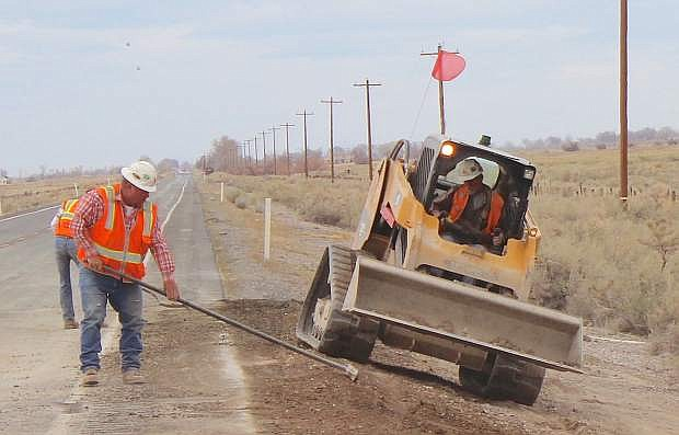 Crews finish last-minute work Wednesday afternoon on one of four culverts on U.S. 95.