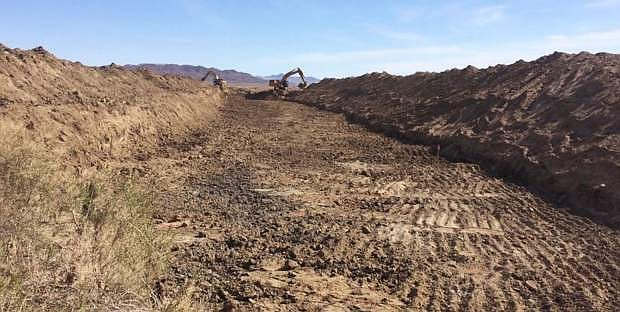 Crews used excavators to dig a drain near Carson Lake to help move extra water to the Stillwater National Wildlife Refuge.