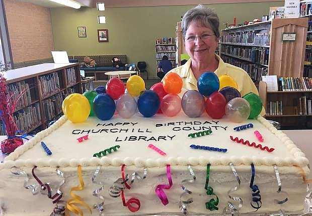 Churchill County Library celebrates its special birthday with a cake by Cheryl Scherschel (pictured) that included edible balloons.