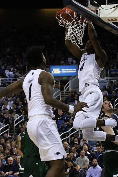 Nevada's Cameron Oliver dunks against Colorado State in the second half while Marcus Marshall (1) watches.