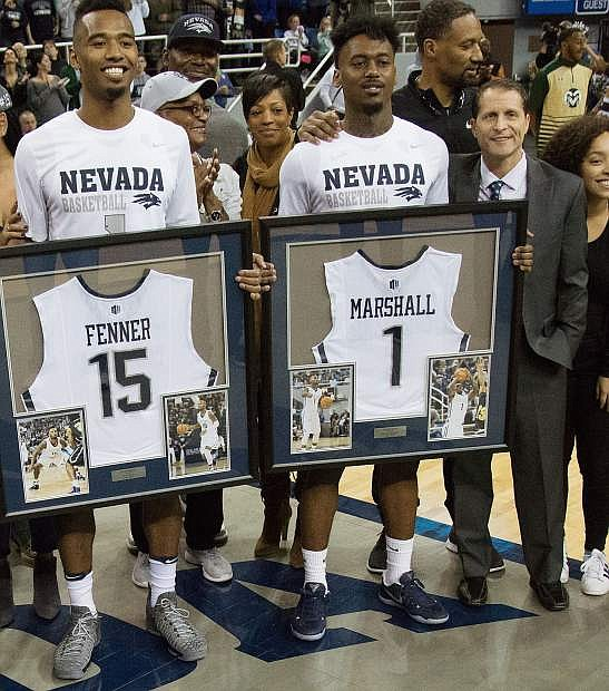 Nevada seniors D.J. Fenner, left, and Marcus Marshall were honored before the regular-season finale on Saturday.
