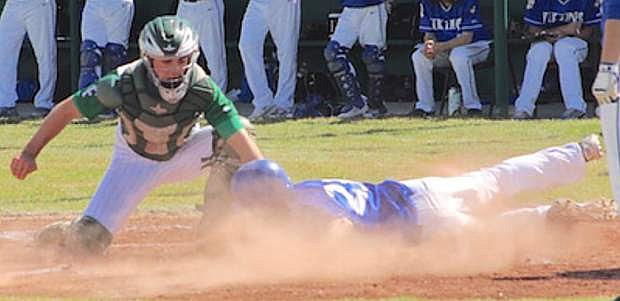 Fallon catcher Brock Uptain tags out South Tahoe's Garret Harley at the plate in Friday's first game of a doubleheader.