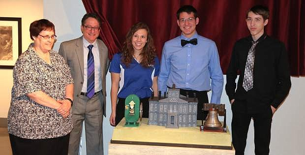 Carson High School instructor Sherri Kelley; Nevada State Museum director Myron Freedman and Carson High students Makaela Bigley, Zachary Vestal and Skylor Olshefsky pose for a picture at a ceremony on Tuesday to mark the donation of 3-D printed replicas of the Carson City Mint to the museum.