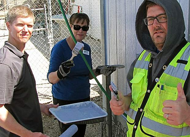 From left: Brent Farr of Farr West Engineering, Cheryl Couch, Community Programs Director for USDA Rural Development, and Yerington Public Works Director Jay Flakus paint the Yerington Animal Shelter as part of an Earth Day Service Project April 19 on Yerington.