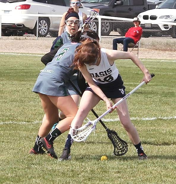 Emily Richards, right, battles a Damonte player for a groundball.