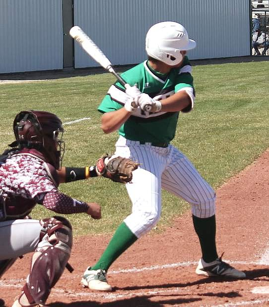 Edgar Alvarado, 21, prepares for a pitch during the Greenwave's game against Elko.