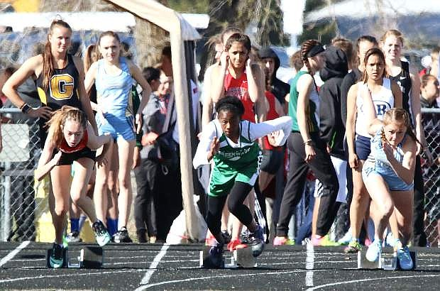 Fallon's Kyndal Collins sprints out of the blocks during the 100-meter trials on Friday.