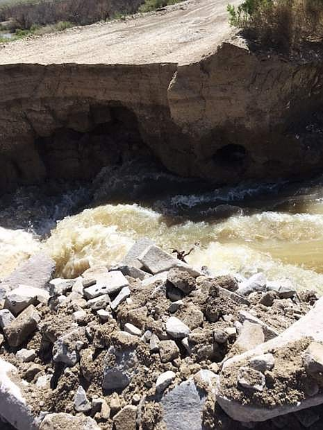 This is a portion of the embankment and dam that were breached Thursday by undermining water in Sheckler Reservoir.