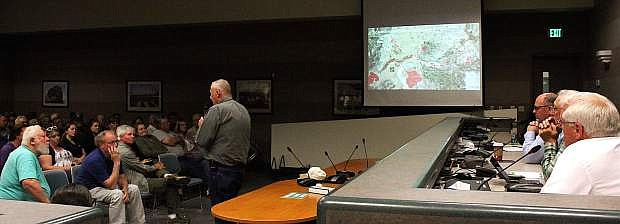 Incident Commander Bill Lawry addresses a town hall meeting on Tuesday to discuss flood preparations for Churchill County.